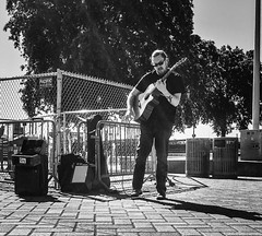 Rock'n'Roll Sunday (TMimages PDX) Tags: road street city people urban blackandwhite musician music monochrome buildings portland geotagged photography photo image guitar streetphotography streetscene sidewalk photograph pedestrians pacificnorthwest streetperformer avenue fineartphotography iphoneography