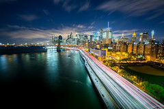 Night Downtown 1 (Jakub Slovacek) Tags: road city nyc longexposure travel sky urban usa newyork building cars water skyline architecture night clouds skyscraper river lights downtown cityscape manhattan sightseeing trails landmark parkway brooklynbridge eastriver metropolis hdr