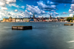 Gamla stan, Stockholm (Nicole Joos Photography) Tags: city longexposure blue houses summer water colors skyline clouds buildings island colorful wasser cityscape colours bright sweden stockholm outdoor schweden capital stan sverige colourful oldtown cloudscape gamla