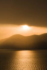 Golden eye (NuKeglus) Tags: paesaggio gardalake gold tramonto lagodigarda landscape