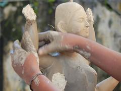 An artist giving shape to an idol of Hindu goddess Manushya. (Shafi Uddin1) Tags: temple hindugoddess hindu manushya working world clayfaces clay bangladesh asia horizontal streetportrait portrait goddess nikon nikkor40136mm nikkor nikoncoolpixl830 nikonlens nikoncoolpix ngc supershot beautiful beautifulbangladesh bangladeshstreetphotograph bangladeshi bangali bangladeshiculture streetsofnetrokona netrokona religiousfestival religious festival biggestreligiousfestival artist puja street