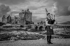Eilean Donan Bagpipes (henderz86) Tags: landscape portrait clouds bw black white sky castle bagpipes kilt scotland sea mood contrast nikon d5100