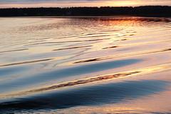 Sunset reflections (evisdotter) Tags: sunset reflections speglingar light colors water evening nature sooc seascape lemstrm land