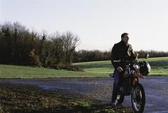 Motard (Sarah Devaux) Tags: homme moto honda 125 casque blond vénétien champs forêts hiver route tournage ruffec charente campagne troisquarts vert colines orange ciel argentique