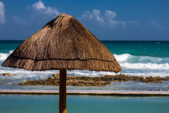 Umbrella (drpavloff) Tags: ocean blue shadow sea sky beach nature water pool clouds umbrella sand waves side palm shore palmtree shade palapa naturalbeauty seashore palmthatch photographyforrecreation