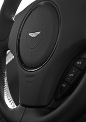 Aston Martin Vanquish (TP Photography & Design) Tags: camera bw 6 brown house david black classic monochrome beauty car leather contrast canon emblem circle logo photography eos design photo focus driving power angle martin d buttons interior details royal automotive db sharp plush event chrome photograph badge frame controls automatic button metalwork british motor airbag 500 dslr satin shape brand period orientation luxury 60 branding aston rotary astonmartin polished filling aluminium 59 rendezvous liter 2012 litre badging refined 500d 2011 framefilling aspirated normallyaspirated