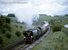 M018-00092 (railphotolibrary.com) Tags: city trees england train golden countryside europe pacific smoke railway wells steam pullman arrow streamlined preserved pennine 462 uk1 bulleid 34092