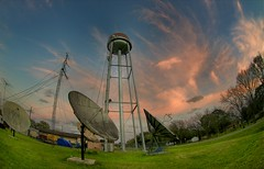 Alien Life (Tom Haymes) Tags: sunset clouds texas dusk watertower fisheye wallis satellitedishes orangeclouds austincounty wallistexas austincountytexas