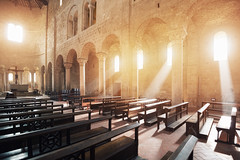 Abbazia di Sant'Antimo (Philipp Klinger Photography) Tags: italien windows light shadow italy church window abbey stone architecture bench sand nikon sandstone warm europa europe italia ray shadows pillar arc warmth arches medieval tusca
