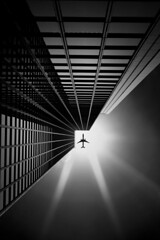 Portal (Kapuschinsky) Tags: blackandwhite bnw monochrome bnwfineart fineart monochromaticfineart dramatic emotive moody leadinglines symmetry plane jet aviation conceptual conceptualcomposite flare sunflare airplane geometry lines kapuschinsky sonyalpha sonya700 natuallight naturallight socal southerncalifornia dtla losangeles la california building skyscraper architecture city urban
