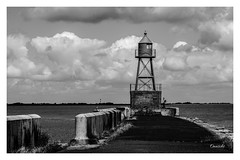 Lighthouse (Onascht) Tags: lighthouse mole niedersachsen nikond610tokina100mmf28atxprodlens wilhelmshaven wolken bicycle black clouds meer northsea schwarzweis sea white