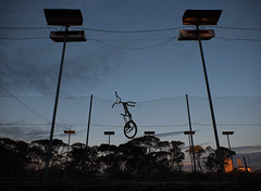 [watchupga] (Shovelling Son) Tags: watchupga bmx court tennis lights fence mallee trees silo sunset