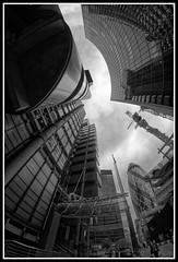 Lloyd's Building looking upwards (jim_2wilson) Tags: rokinon8mmf35 sonya77 jimwilson london wideangle fisheye lloydsbuilding gherkin bw dxoopticspro