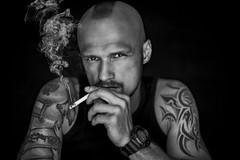 Iroquois (jimisolek) Tags: iroquois irokez man tattoo smoke cigarette black white bw eyes hair