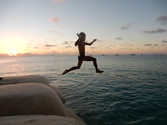 Acrobatic Jump (mikecogh) Tags: tuvalu funafuti boy jumping action sea swimming
