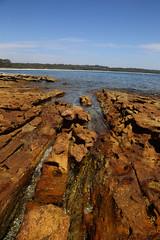 Rock (Bert#) Tags: ocean travel blue brown seascape rock bay coast colorful perspective australia jervis