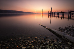 Reichenau Sunset (PhiiiiiiiL) Tags: sunset sun lake water stone landscape nikon wasser long exposure sonnenuntergang insel steine bodensee holz sonne stein constance steg langzeitbelichtung pfahl reichenau nd30 d800e