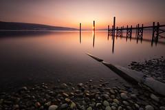 Reichenau Sunset (PhiiiiiiiL) Tags: sunset sun lake water stone night landscape nikon wasser long exposure sonnenuntergang insel clear steine bodensee holz sonne stein constance steg langzeitbelichtung pfahl reichenau nd30 d800e