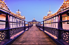 Pier in the Evening, Eastbourne (Asquiff) Tags: uk longexposure sunset england beach night stars lights sussex evening coast pier seaside nikon wideangle clear eastbourne rails hdr starburst tearooms sigma1020mm converging leadinglines d90