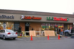 An old lady mistook her accelerator for the brake, and drove into Little Ceasar's (Librarianguish) Tags: broken window car crash boardedup smashed 213 plywood cones bashed