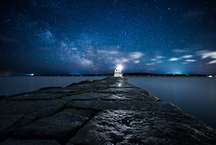 Breakwater Blues (moe chen) Tags: ocean sky lighthouse water night clouds way stars atlantic milky beacon breakwater rockland