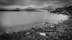 At the Forth Bridge again... (Wan ~stuck in catch up loop) Tags: longexposure bridge blackandwhite shells scotland rocks le southqueensferry forthrailbridge sigma1020mmdchsm nikond7000 wmekwiphotography mekwicom