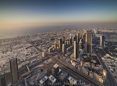 Little Dubai. (Ollie Smalley Photography (OSP)) Tags: ocean road blue houses sunset sea sky orange distortion black water glass vertical contrast canon buildings high construction motorway horizon small perspective landmarks down clear khalifa tiny 5d tall hotels expressway residential iconic manualfocus f28 burj residences tallest osp sheikhzayedroad spaghettijunction 14mm worldstallestbuilding manualexposure samyang manualaperture 5d2 canon5dmarkii samyang14mmf28mf