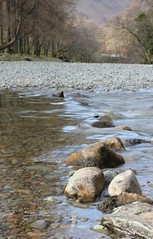 Lake District River (PhilBehan) Tags: trees england lake west reflection water rock river flow rocks stream afternoon stones district north lakes bank pebbles cumbria keswick banks baller lakestrip