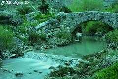 Puente romano (E.M.Lpez) Tags: verde primavera ro puente agua abril paisaje granada campo riachuelo arroyo vegetacin cascada piedra puenteromano 2013 colomera saltodeagua efectoseda