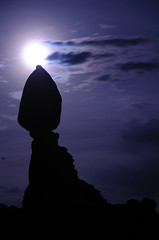 Balanced Rock at Night, Arches NP (allisonherreid) Tags: travel blue light vacation sky usa moon black tourism nature silhouette rock stone night clouds america dark landscape utah nationalpark natural arches moonrise moab outline archesnationalpark balanced balancedrock allisonherreid