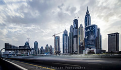 Freeway Rush. (Ollie Smalley Photography (OSP)) Tags: city sky cars skyline clouds buildings grey lights construction dubai cityscape gloomy towers transport uae vehicles motionblur lee transportation getty 5d tall lighttrails roads fullframe residential ff unitedarabemirates hdr highdynamicrange futuristic offices clearsky gettyimages hdri tallest osp cloudage neutraldensityfilter 10stopndfilter 5d2 princesstower 5dii canon5dmarkii solidnd leebigstopper lightroom4 clouddrag olliesmalleyphotography