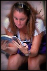 Revealing reader (David Lavine) Tags: girl reading cleavage barcelona downblouse qwurky book longhair upskirt boobs sexy
