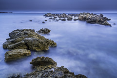 The Reef (bjrn_c) Tags: blue water horizon sea rock cliff reef