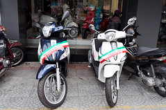 Italian style (Roving I) Tags: italian style motorcycles motorbikes piaggio stripes displays design engineering vehicles distributorships onsale saigon shops stores hcmc hochiminhcity vietnam