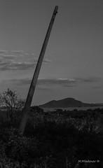 Tilted pole (Milen Mladenov) Tags: 2016 august bw blackandwhite bulgaria d3200 nikon varbovchets bushes clouds grass mountain pole sky strange summer sunset tree