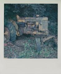 Derelict (DavidVonk) Tags: vintage instant analog film polaroid slr680 impossibleproject antique tractor moss mossy lichen farm equipment belt flywheel yellow rusty