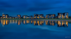 Blue hour cityscape with reflection of Deventer. (Bart Ros) Tags: ifttt 500px landscape landmark water waterfront city cityscape clouds cloudscape cloudy blue hour reflection reflections reflect yellow buildings building architecture architectural panorama panoramic long exposure pentax travel deventer ijssel overijssel holland nederland netherlands