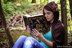 Discovering New Worlds (aldenfrautschy) Tags: reading batman sabine portrait outside outdoors woods lotr lordoftherings kingarthur sword forrest hobbit cloak smart geeky girl female woman cute canon fireplace laying bed bedroom upside down comfy adobe lightroom