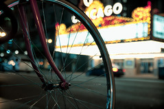 State Bicycle (EXPLORE 02/19/13) (benchorizo) Tags: city urban chicago bicycle wheel nikon downtown cityscape dof bokeh bikes nightshots statestreet downtownchicago chicagotheater chicagoist banias citynights d90 benchorizo romeobanias