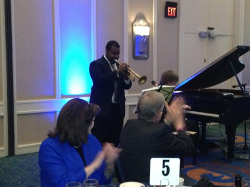 <p>An enthusiastic Bishop Hahn leads the applause for amazing musical talent Michael Cruse and his pianist Jackson. Michael, who is a protege of Winston Marsalis, graduated from Lexington Dunbar High School. He and Jackson are students at Cincinnati Conservatory of Music</p>