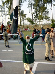 Old Man with Natoinal Flag at the Evening Flag Lowering Ceremony at the India-Pakistan International Border, Wagah (tyamashink) Tags: pakistan