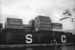 Shipping Containers on the Najran (Alexander Rabb) Tags: nyc newyorkcity ny newyork film boat blackwhite newjersey nikon ship kodak nj statenisland nikkor containership nikonf bayonne shippingcontainer 125px newyorkharbor najran nikkorsauto35mmf28 killvankull kodakplusx125 hiddenharbortour workingharborcommittee