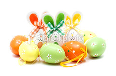 Easter bunnies and eggs (imagesstock) Tags: holiday rabbit bunny green animal yellow easter season rodent spring egg event whitebackground celebrations gift bow eggs ribbon  isolated easterbunny nationalholiday easteregg  coloredeggs babyrabbit          isolatedonwhite animalear celebrationevent holidaysandcelebrations animalsandpets tiedknot animalegg