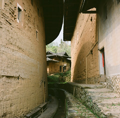 O &  (kymak) Tags: china city red house mountain tower film architecture circle square living village culture tourist round vernacular fujian hakka 2010  dwelling tulou   earthenbuilding longyan  schneiderxenar3575 rolleiflex35a  modelk4a automat6x6 mxtype2