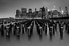 The Sticks (Mike Orso) Tags: park city nyc newyorkcity longexposure blackandwhite ny newyork tower water monochrome skyline brooklyn night skyscraper buildings print puddle photography pier photo downtown gallery cityscape unitedstates image manhattan worldtradecenter fineart stock scenic picture dumbo canvas wtc pylons pillars piles brooklynbridgepark tower1 freedomtower downtowncity dumbopark mikeorso