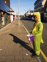 Crocodile Smile (Posh Audrey) Tags: road street charity shadow money lamp smile lines yellow bucket post pavement teeth alligator cardiff trainers sidewalk crocodile shops shake sainsburys fundraising onesie woodville cathays