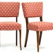 54. Pair of French Sabre Leg Chairs