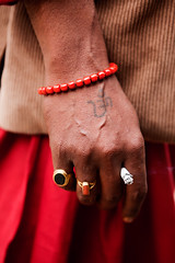 (Constantine Savvides) Tags: red india festival tattoo religious asia peace hand mark cigarette indian smoke traditional main religion smoking ring holy rings bracelet asie tradition om hindu hinduism marking pilgrim aum inde fumee tattooed mysticism tatou tattou