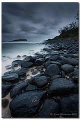 Living on Earth is expensive, but it does include a free trip around the sun. (danishpm) Tags: beach seaside sand rocks seascapes cloudy australia nsw noxiousweed 1740mmf40l fingalheads canon5dmkiii basaltrockformation sorenmartensen tweedarea 06ndsoftgrad hitechgradfilter