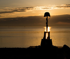 Battlefield Cross Memorial (Dalliance with Light) Tags: ocean sun monument water silhouette sunrise dawn memorial boots rifle helmet nj atlantic raritan southamboy raritanbaywaterfrontpark fallensoldierbattlecross oceanraritanbay sergeantfirstclassbejaminlsebbaniraqwarmemorial